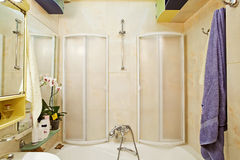 Modern small shower-bath with shower-cubicle. Modern small shower-bath plastic with shower-cubicle Stock Photo