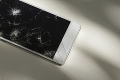 Modern phone with broken screen. Modern smart phone with broken screen stock images