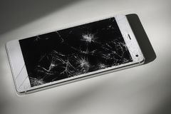 Modern smart phone with broken screen. Modern phone with broken screen stock photos