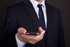 Modern smart phone in business man hand Stock Photo