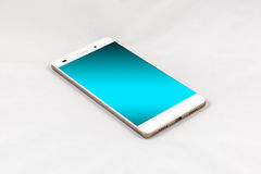 Modern smartphone with blank blue screen, isolated on white back. Modern smartphone with blank blue screen, lies on the surface, isolated on white background stock image