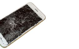 Modern smartphone with broken screen. Modern smartphone with highly broken screen isolated on white background. Free space stock images