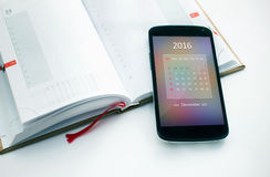 Modern smartphone calendar for 2016. Royalty Free Stock Photography