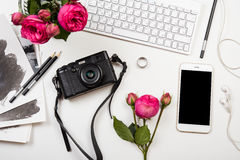 Modern smartphone, computer keyboard, pink flowers and photo cam Royalty Free Stock Photos