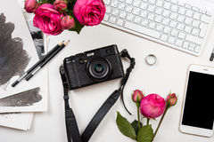 Modern smartphone, computer keyboard, pink flowers and photo cam Stock Photography