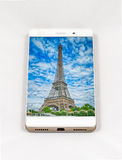 Modern smartphone displaying full screen picture of Paris, Franc Stock Photo