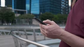 Smartphone in hands of tourist, typing messages