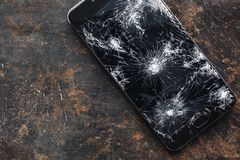 Big modern smartphone with broken screen debris stock photos