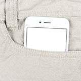 Modern smartphone in the pocket Royalty Free Stock Image