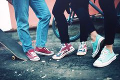 Modern sneakers worn by friends, urban lifestyle of modern clothing and footwear Royalty Free Stock Image