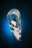 Modern snowshoe under view on gradiant black and blue Royalty Free Stock Photography
