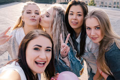 Modern social communication. Female friendship. Happy girls taking selfie on street point of view Stock Photography