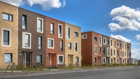 Modern Social housing under blue sky. In terra colors containing modest family apartment houses in Ypenburg, The Hague, Netherlands Royalty Free Stock Photo