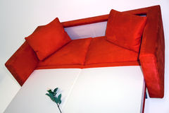 Modern sofa. Modernly designed, covered by high quality red textile. Including expandable mechanism Stock Image