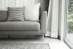 Modern sofa. Beige contemporary modern sofa with grey cushions Stock Images
