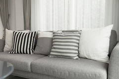 Modern sofa. Beige contemporary modern sofa with grey cushions Royalty Free Stock Photo