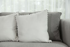 Modern sofa. Beige contemporary modern sofa with grey cushions Royalty Free Stock Image