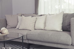 Modern sofa. Beige contemporary modern sofa with grey cushions Royalty Free Stock Photography