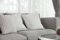 Modern sofa. Beige contemporary modern sofa with grey cushions Royalty Free Stock Photos