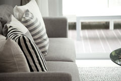 Modern sofa. Beige contemporary modern sofa with grey cushions Stock Photos