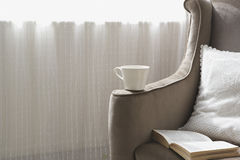 Modern sofa with a coffee cup Royalty Free Stock Image
