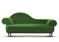 Modern sofa. Covered with bright green grass. 3d rendered vector illustration