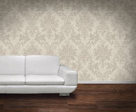 Modern sofa on dark floor Stock Images