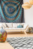 Modern sofa and ethnic cloth royalty free stock photography