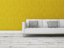 Modern sofa in front of a yellow wall Stock Photo