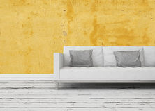 Modern sofa in front of a yellow wall Royalty Free Stock Photos