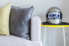 Modern sofa with helmet Royalty Free Stock Photo