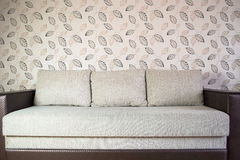 Modern sofa in an interior room view Stock Images
