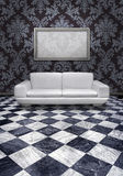 Modern sofa on marble floor Stock Images