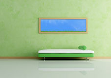 Modern sofa and picture against green wall Stock Photography