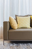 Modern sofa with pillows in living room Stock Photo