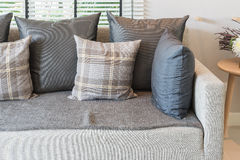 Modern sofa and set of pillows in modern bedroom Royalty Free Stock Photos