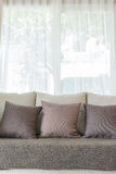 Modern sofa and set of pillows in modern bedroom Stock Photo