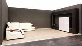 Modern sofa with skin tapestry. Modern bedroom with sofa and skin tapestry Stock Photography