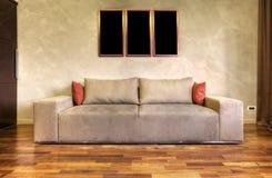 Modern sofa in a white living room Stock Photos