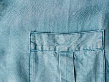 Lyocell or tencel blue denim pattern texture. Modern soft jeans blouse with breast pocket texture close up. Lyocell or tencel pattern - modern natural cellulose royalty free stock image