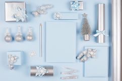 Modern soft minimalist christmas background - various blue and silver metallic gift boxes with shiny ribbons and bows. Modern soft minimalist christmas stock photo