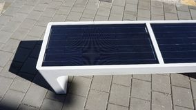 modern solar bench for using alternative energy Stock Photo