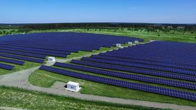 Modern solar farm producing clean renewable energy. Solar energy business. Concept. Aerial landscape rows of solar photovoltaic panels stock video footage