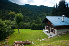 Modern Solar Log Cabin French Alps. A modern chalet in the forests of the French Alps Royalty Free Stock Photos
