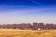 Modern solar power plant in the sunny plain. Royalty Free Stock Photo