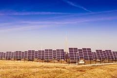 Modern solar power plant in the sunny plain. Royalty Free Stock Photo