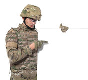 Modern soldier holding a poster Stock Photography
