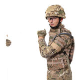 Modern soldier holding a poster Royalty Free Stock Photos