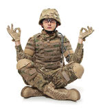 Modern soldier meditating. Isolated on a white background royalty free stock photo
