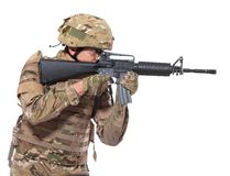 Modern soldier with rifle. Isolated on a white background Stock Photo